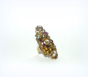 MAESTOSO, COD LML AN 03 anello decorato con strass acrilici sfumati da oro ricavato da pigmenti in polvere. La base è una filigrana in oro e l'anello è in ottone di altissima qualità e consistenza, regolabile.REPLICABILE E PERSONALIZZABILE